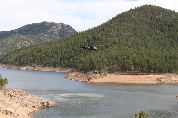 2019-04-09 Helicopter with water bucket at Button Rock Preserve